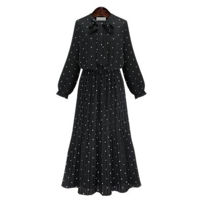 Wholesale Women's Clothing Nihaostyles Polka Dot Print Long-sleeved Bohemian Pleated Long Dress NSXIA65500