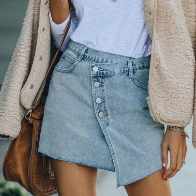 Wholesale Women's Clothing Nihaostyles Oblique Buckle Solid Color Raw Edge Bag Hip All-match Denim Skirt NSXMI66136